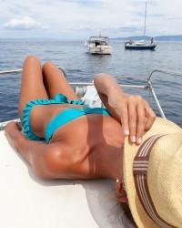 Attractive girl sunbathing on a yacht
